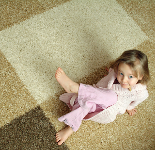 little-girl-relaxing-on-carpet